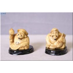 Two antique carved and signed ivory netsuke