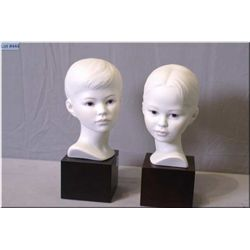 """A pair of Cybis porcelain busts including a boy and girl 10"""" in height"""