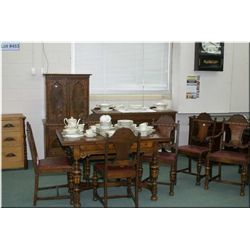 An apartment sized antique oak and walnut draw leaf dining table with table, four chairs and sideboa