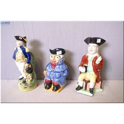 """Three antique toby jugs including two unmarked and one Staffordshire 8"""" in height"""