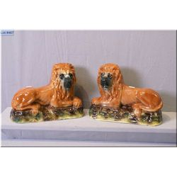 """A pair of Lion motif Staffordshire style mantle pieces 13"""" in length"""