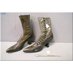 A pair of leather Victorian button up Rosenthal boots and a British hallmarked sterling button hook