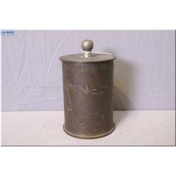A vintage Trench art tobacco pot made from 105 mm shell casing with African motif and dated 1943-194
