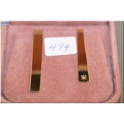 Two Birks 10kt yellow gold tie clips, one set with small single diamond