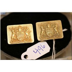 A pair of Birks 10kt yellow gold cufflinks with coat of arms motif decoration