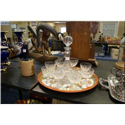 A crystal ship's decanter and a selection of crystal glasses