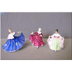"Three small Royal Doulton figurines including ""Elaine"" HN3214, ""Kirsty"" HN3213 and ""Sara"" HN3219"