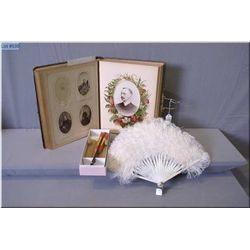A Victorian photo album with large selection of early photographs plus a feather fan and an Asian fa