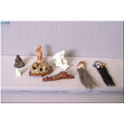 A collection of vintage Asian motif figures