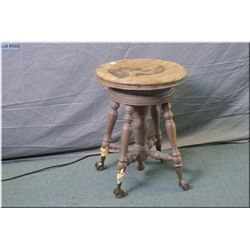 Vintage piano stool on cast and glass ball and claw feet, needs tlc
