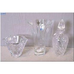 A heavy pinwheel crystal decanter, a Mikasa crystal bowl and a hand blown crystal flower vase