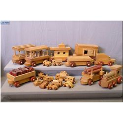 A selection of handmade wooden toys including planes, trains and automobiles