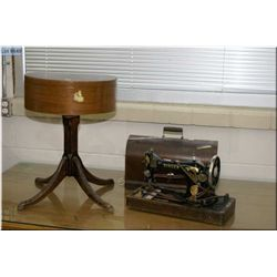A vintage radio cabinet repurposed to a sewing table and a Singer portable sewing machine