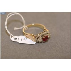 Ladies 14kt yellow gold, diamond and ruby ring set with 0.61ct of oval shaped natural ruby and 0.59c