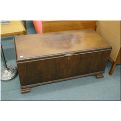 A matched grain walnut cedar lined blanket box made by the Honderich Furniture Co.