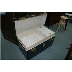 Blue metal steamer trunk with brass coloured binders and hardware with tray