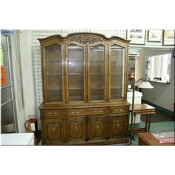 Semi-contemporary chest of chest illuminated china cabinet by Thomasville