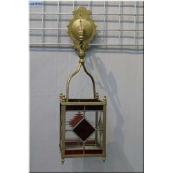 Brass leaded panelled hurricane shade with cast lion motif hanger