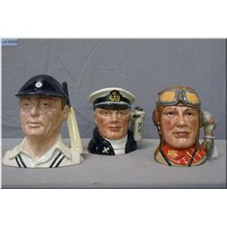 "Three small Royal Doulton character jugs including ""The Airman"" D6903, ""The Hampshire Cricketer"" D67"