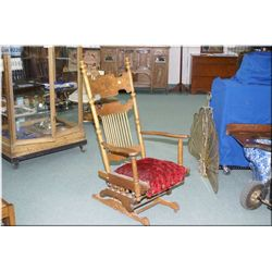 American carved quarter cut oak glider chair circa 1900 on castors, note casting marks in hardware