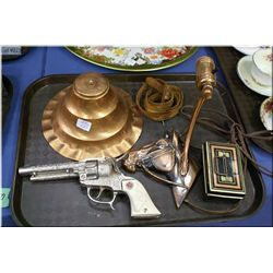 A horse motif wall mount lamp, a vintage cap gun and a small metal money box