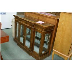 Semi-contemporary two door low display cabinet with bevelled panels