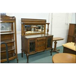 Antique Canadiana quarter cut oak sideboard with leaded panels, bevelled mirrored backboard