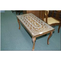 Heavily inlaid animal motif coffee table with glass top protector