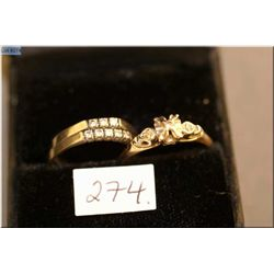 Three vintage ladies gold and diamond ring including two 14kt white gold wedding bands set with diam