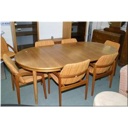 Danish teak dining table with two large insert leaves and eight dining chairs
