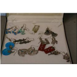 Twelve pairs of silver earrings including turquoise, cats, dragons etc.