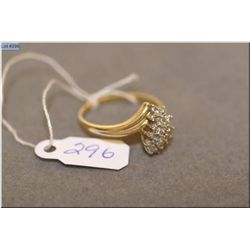 Ladies 14kt yellow gold and 0.25ct diamond cluster ring