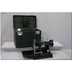 Vintage Singer Featherweight sewing machine in case
