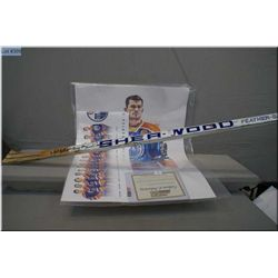 A game used hockey stick signed by Oiler's Craig Simpson plus a 2012-2014 Oiler's roster poster and