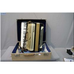 A Horner Concertone Accordian in fitted hard case