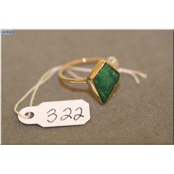 Ladies 10kt yellow gold and green stone ring