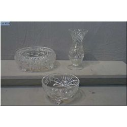 Two footed crystal bowls and a vase