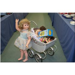 A selection of vintage toys including doll buggy, metal doll trunk, large walking doll etc.