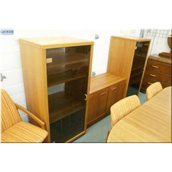 Two smoked glass and teak entertainment units and a low two door server