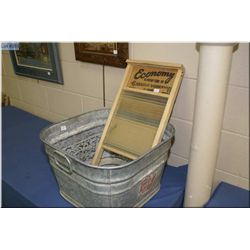 A vintage galvanized tub and an Economy glass and wooden washboard