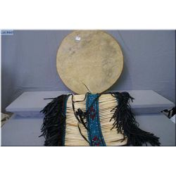 A native American bone and bead breastplate and a hide drum