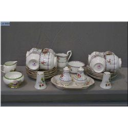 Selection of Royal Albert Petitpoint including eight cups and saucers, cream sugar, salt/pepper and