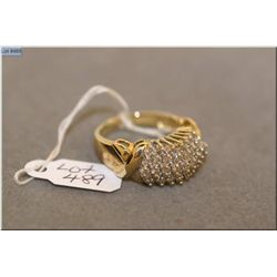 Ladies 10kt yellow gold and diamond ring set with approximately 1.00ct of brilliant white diamonds.