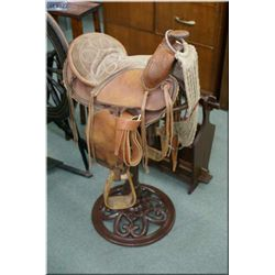 Child's size western saddle and metal saddle stand