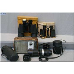 Three pair of binoculars including a Carl Wetzlater 10X50, camera lenses and portable radio