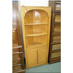 A oak corner unit with open shelves and under storage made Hammond Furniture Co.