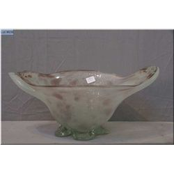 A hand blown cased glass bowl with applied clear glass feet