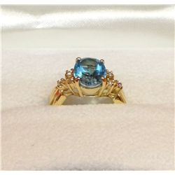 Oval topaz & Diamond ring, 14 kt. Yellow gold setting
