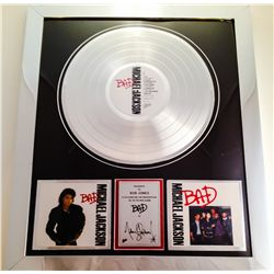 MICHAEL JACKSON AND BOB JONES SIGNED PLATINUM RECORD AWARD FOR BAD PRESENTED TO BOB JONES