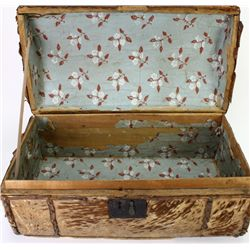 Early tacked leather travel trunk with original